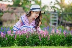 Beautiful woman on a flower garden royalty free stock photos