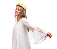 Beautiful woman with a flower garland and a white dress Royalty Free Stock Photography