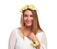 Beautiful woman with a flower garland and a white dress Royalty Free Stock Photos