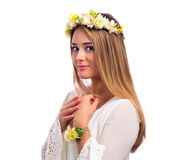 Beautiful woman with a flower garland and a white dress. Beautiful young woman with a flower garland and a white dress isolated on a white background Stock Photo