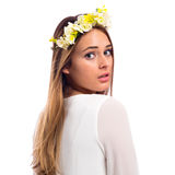 Beautiful woman with a flower garland and a white dress Royalty Free Stock Image