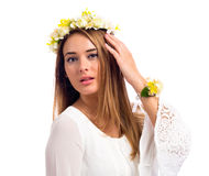 Beautiful woman with a flower garland and a white dress Stock Images