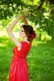Beautiful woman with a flower in the hairstyle Stock Images