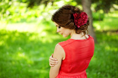 Beautiful woman with a flower in the hairstyle Stock Image