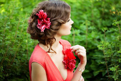 Beautiful woman with a flower in the hairstyle Stock Photo