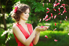 Beautiful woman with a flower in the hairstyle Stock Photos