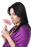 Beautiful woman with flower in hands. Stock Photos