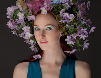 Beautiful Woman in Flower Headpiece Stock Image