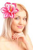 Beautiful woman with flower in her hair. Portrait of beautiful woman with flower in her hair isolated on white background Stock Images