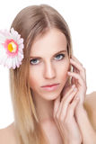 Beautiful woman with a flower in her hair Stock Photo