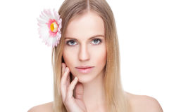 Beautiful woman with a flower in her hair Royalty Free Stock Photo