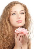 Beautiful woman with flower in her hands Stock Image
