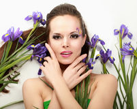 Beautiful woman with flower iris, isolated on Royalty Free Stock Images