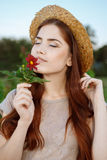 Beautiful woman with a flower at the park Royalty Free Stock Photography
