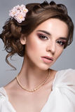 Beautiful woman with flower. Beautiful woman portrait with nice make up and flower in hair. Bride Stock Photo