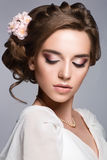Beautiful woman with flower. Beautiful woman portrait with nice make up and flower in hair. Bride Royalty Free Stock Photo