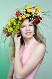 Beautiful woman with flower wreath Stock Photos