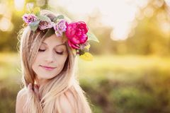 Beautiful woman with flower wreath. Royalty Free Stock Photos