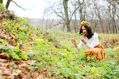 Beautiful woman with flower wreath on her head in the autumn nature Stock Photo