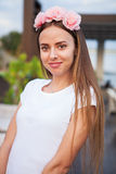 Beautiful woman with flower wreath. stock photos