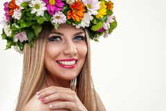 Beautiful woman with flower wreath Stock Image