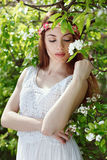 Beautiful woman in a flowered orchard Royalty Free Stock Photo