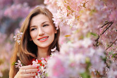 Beautiful woman in the flowering spring garden stock image