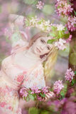 Beautiful woman and flowering tree stock photo