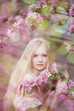 Beautiful woman and flowering tree Royalty Free Stock Photography
