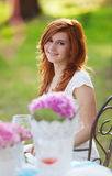 Beautiful woman with flowerpot Royalty Free Stock Photos