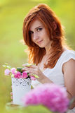 Beautiful woman with flowerpot Stock Photos