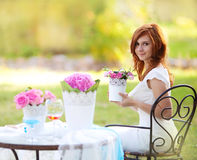 Beautiful woman with flowerpot Royalty Free Stock Photo