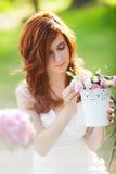 Beautiful woman with flowerpot Stock Photo