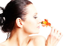 Beautiful woman with flowers Stock Photo