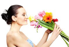 Beautiful woman with flowers Royalty Free Stock Photos