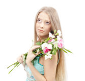 Beautiful woman with flowers. In elegant blue sundress over white. Fashion photo Stock Photography