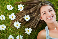 Beautiful woman with flowers Stock Images