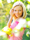 Beautiful woman with flowers. In a park royalty free stock photo