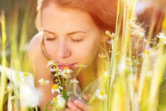 Beautiful woman with flowers. Stock Photo