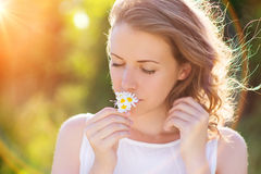 Beautiful woman with flowers. Stock Photography