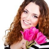 Beautiful woman with flowers and bags Stock Photography