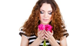 Beautiful woman with flowers and bags Royalty Free Stock Photo
