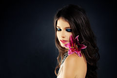Beautiful Woman with Flowers. Blue Eye Shadow Royalty Free Stock Images