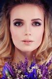 Beautiful Woman with Flowers. Cute Face Closeup Stock Photo