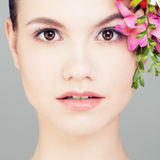 Beautiful Woman with Flowers. Face Closeup Royalty Free Stock Photos