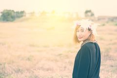 Beautiful woman in the flowers field on sunset. Royalty Free Stock Photos