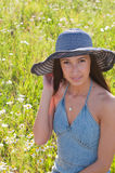 Beautiful woman on the flowers field Stock Images