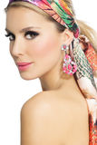 Beautiful Woman In Flowers. Beautiful glowing woman in summer fashion silk scarf Stock Photos