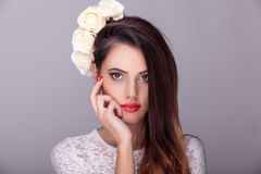 Beautiful woman flowers in head on grey background Royalty Free Stock Photography