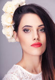 Beautiful woman flowers in head on grey background Royalty Free Stock Images